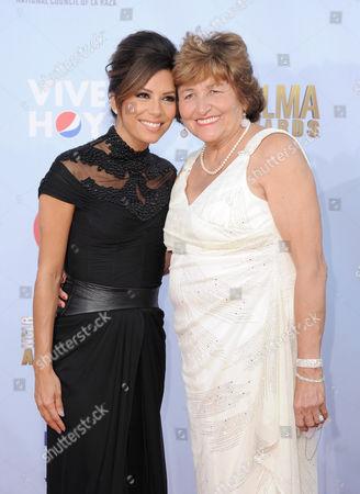 Eva Longoria, left, and Ella Eva Mireles arrive at the ALMA Awards, in Pasadena, Calif