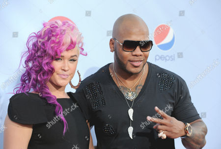 StayC, left, and Flo Rida arrive at the ALMA Awards, in Pasadena, Calif
