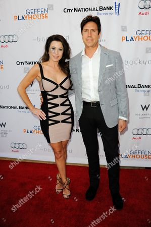 """Nelson De La Nuez, right, and Stacy De La Nuez arrive at the annual """"Backstage At The Geffen"""" event at the Geffen Playhouse on in Los Angeles"""