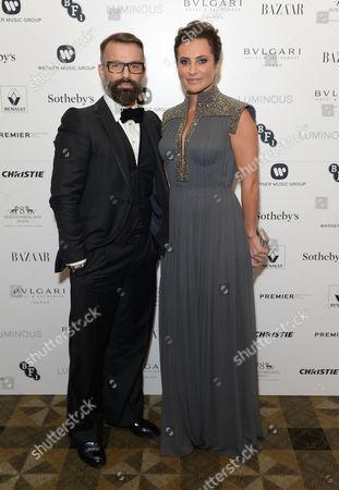 Ella Krasner wearing Nicholas Oakwell Couture (right) and designer Nicholas Oakwell attend BFI Luminous Fundraising Gala, in London