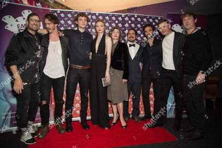 From left, director Ian Bonhote, actors Sam Keeley, Josh Whitehouse, Eleanor Tomlinson, Camilla Rutherford, Juan Cely, Virgile Bramly, Frederick Schmidt and producer Andee Ryder pose for photographers upon arrival at the premiere of the film 'Alleycats', in London