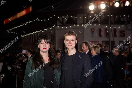 Stock Image of Actor Edvin Endre, right and guest pose for photographers upon arrival at the premiere of the film 'Eddie the Eagle' in London
