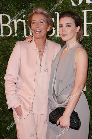 Actress Emma Thompson, left and daughter Gaia Romilly Wise pose for photographers upon arrival at the Evening Standard British Film Awards 2016 in London