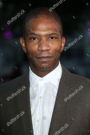 Actor Mark Monero poses for photographers upon arrival at the premiere of the film 'Free Fire', which is the London Film Festival closing gala screening in London
