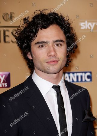 Toby Sebastian poses for photographers upon arrival at the Tower of London for the world premiere of Game of Thrones, season 5, in London