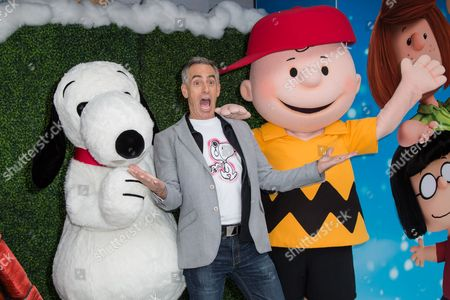 """Director Steve Martino poses for photographers upon arrival at the gala screening of """"Snoopy and Charlie Brown: The Peanuts Movie"""" in London"""