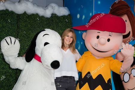 """Helen Fospero poses for photographers upon arrival at the gala screening of """"Snoopy and Charlie Brown: The Peanuts Movie"""" in London"""