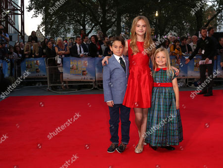 Stock Photo of Bobby Smalldridge, Emelia Jones and Harriet Turnball, arrive for the World Premiere of 'What We Did On Our Holiday', at the Odeon West End in central London