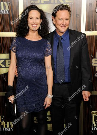 "Actor Judge Reinhold and his wife Amy pose together at ""Eddie Murphy: One Night Only,"" a celebration of Murphy's career at the Saban Theater, in Beverly Hills, Calif"