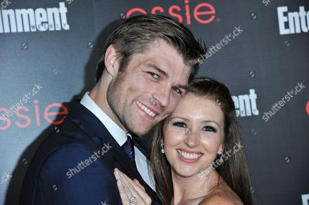 Liam McIntyre, left, and Erin Hasan arrive at the Entertainment Weekly Screen Actors Guild Party at the Chateau Marmont on in Los Angeles