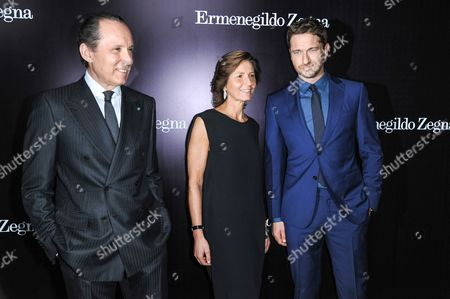 From left, Gildo Zegna, Anna Zegna, and Gerard Butler arrive at the Ermenegildo Zegna Boutique opening on in Beverly Hills, Calif