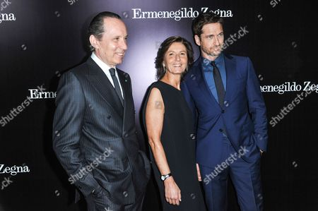 From left, Anna Zegna, Gildo Zegna, and Gerard Butler arrive at the Ermenegildo Zegna Boutique opening on in Beverly Hills, Calif