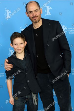 Actor Ivo Pietzcker and director Edward Berger pose for photographers at the photo call for the film Jack during the International Film Festival Berlinale in Berlin