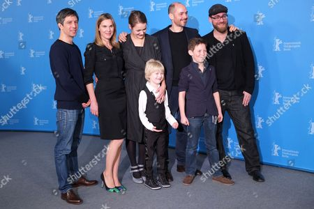 Stock Photo of Clockwise from top left, Cameraman Jens Harant, screenwriter Nele Mueller-Stoefen, actress Luise Heyer, director Edward Berger, producer Jan Krueger, actor Ivo Pietzcker and actor Georg Arms pose for photographers at the photo call for the film Jack during the International Film Festival Berlinale in Berlin