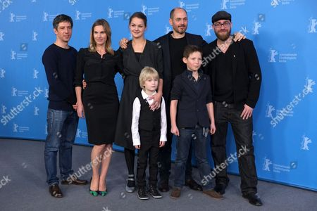 Clockwise from top left, Cameraman Jens Harant, screenwriter Nele Mueller-Stoefen, actress Luise Heyer, director Edward Berger, producer Jan Krueger, actor Ivo Pietzcker and actor Georg Arms pose for photographers at the photo call for the film Jack during the International Film Festival Berlinale in Berlin