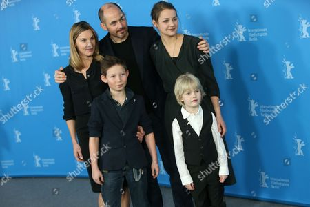 Stock Image of From left, screenwriter Nele Mueller-Stoefen, Edward Berger, Luise Heyer, Ivo Pietzcker and Georg Arms pose for photographers at the photo call for the film Jack during the International Film Festival Berlinale in Berlin