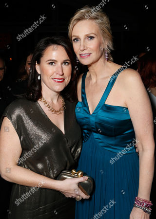 Actress Jane Lynch, right, and Lara Embry attend the Fox Golden Globes Party, in Beverly Hills, Calif