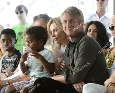 From left to right. Jackson Theron, actress Charlize Theron, and actor Sean Penn attend the generationOn block party at Fox Studios in Los Angeles on