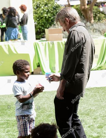 Actor Sean Penn, right, and Jackson Theron attend the generationOn block party at Fox Studios in Los Angeles on