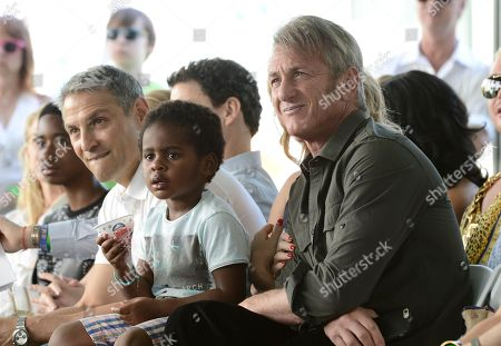 From left to right, WME Co-CEO Ari Emanuel, Jackson Theron, and actor Sean Penn attend the generationOn block party at Fox Studios in Los Angeles on