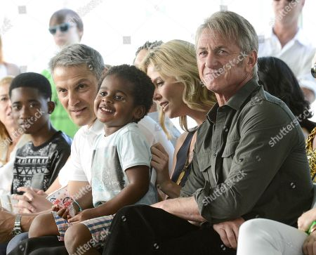 From left to right, WME Co-CEO Ari Emanuel, actress Charlize Theron, Jackson Theron, and actor Sean Penn attend the generationOn block party at Fox Studios in Los Angeles on