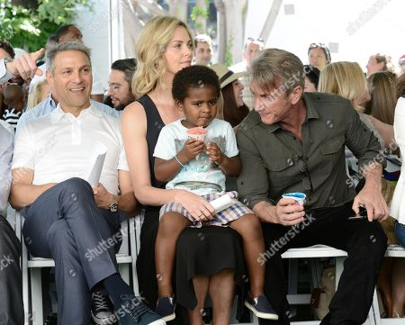 From left to right, WME Co-CEO Ari Emanuel, Jackson Theron, actress Charlize Theron, and actor Sean Penn attend the generationOn block party at Fox Studios in Los Angeles on