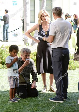 From left to right, Jackson Theron, actor Sean Penn, actress Charlize Theron, and WME Co-CEO Ari Emanuel attend the generationOn block party at Fox Studios in Los Angeles on