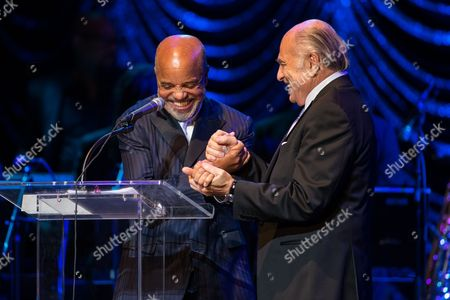Doug Morris (R), Chairman and CEO of Sony Music Entertainment, congratulates Berry Gordy, Jr. on receiving the inaugural Architects of Sound - Vision Award on stage during at the GRAMMY Museum gala tribute concert on in Los Angeles