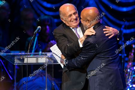 Doug Morris (L), Chairman and CEO of Sony Music Entertainment, congratulates Berry Gordy, Jr. on receiving the inaugural Architects of Sound - Vision Award on stage during at the GRAMMY Museum gala tribute concert on in Los Angeles