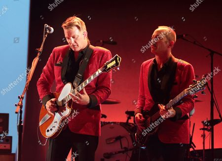 Josh Homme, left and Matt Sweeney perform in concert during their Post Pop Depression Tour 2016 at The Academy of Music, in Philadelphia