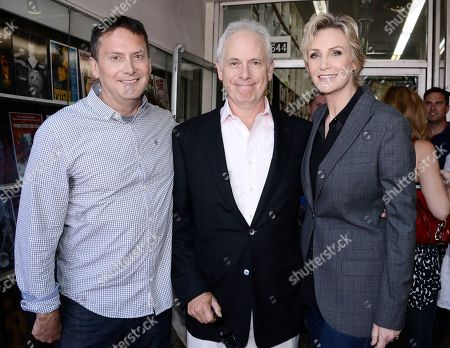 """Emmy-winning actress Jane Lynch, right, poses with actor and director Christopher Guest, center, and actor and producer Michael Hitchcock before being honored with a star on the Hollywood Walk of Fame on in Los Angeles. The ceremony is in celebration of """"Glee"""" The Complete Fourth Season debuting on Blu-ray and DVD on Oct. 1, 2013 from Twentieth Century Fox Home Entertainment"""