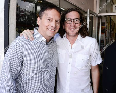 """Actor and producer Michael Hitchcock, left, and writer and co-creator of """"Glee"""" Ian Brennan pose together before Emmy-winning actress Jane Lynch receives a star on the Hollywood Walk of Fame on in Los Angeles. The ceremony is in celebration of """"Glee"""" The Complete Fourth Season debuting on Blu-ray and DVD on Oct. 1, 2013 from Twentieth Century Fox Home Entertainment"""