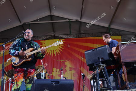 Stock Photo of The Meter Men featuring Zigaboo Modeliste, Leo Nocentelli and George Porter, Jr. with special Guest Page McConnell perform at The New Orleans Jazz & Heritage Festival on in New Orleans, Louisiana