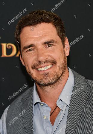 "Stock Photo of Dan Payne, a cast member in ""Descendants,"" poses at the premiere of the film at Walt Disney Studios Main Theatre, in Burbank, Calif"