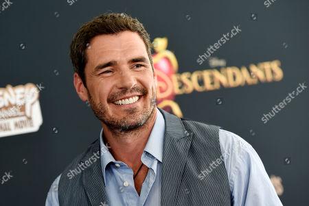 """Dan Payne, a cast member in """"Descendants,"""" poses at the premiere of the film at Walt Disney Studios Main Theatre, in Burbank, Calif"""