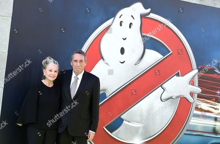"""Ivan Reitman, right, and Genevieve Robert arrive at the Los Angeles premiere of """"Ghostbusters"""" at the TCL Chinese Theatre on"""