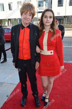 """Rodney Bingenheimer, left and Candice Bowling arrive at the LA Premiere Of """"Love & Mercy"""" at the Samuel Goldwyn Theater, in Beverly Hills, Calif"""