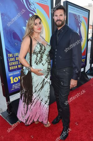 """Shawna Craig, left and Lorenzo Lamas arrive at the LA Premiere Of """"Love & Mercy"""" at the Samuel Goldwyn Theater, in Beverly Hills, Calif"""