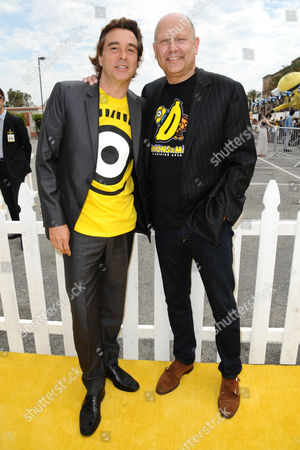 """Composer Heitor Pereira, left, and producer Chris Meledandri arrive at the Los Angeles premiere of """"Minions"""" at the Shrine Auditorium on"""