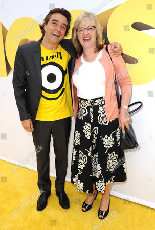 """Composer Heitor Pereira, left, and producer Janet Healy arrive at the Los Angeles premiere of """"Minions"""" at the Shrine Auditorium on"""