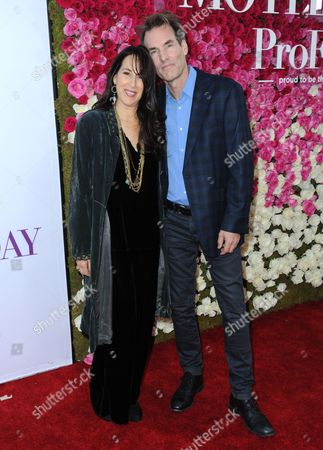 """Maggie Wheeler, left, and Daniel Borden Wheeler arrive at the Los Angeles premiere of """"Mother's Day"""" at the TCL Chinese Theatre on"""