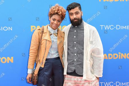 Sonjia Williams, left and Fabio Costa arrive at the Los Angeles Premiere of Paddington at the TCL Chinese Theatre, in Los Angeles