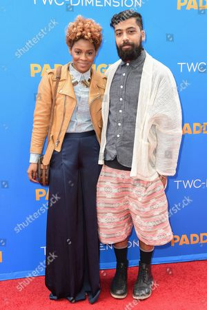 Stock Picture of Sonjia Williams, left and Fabio Costa arrive at the Los Angeles Premiere of Paddington at the TCL Chinese Theatre, in Los Angeles