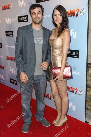 """Stock Picture of Jared Cohn, left, and Sara Malakul Lane attend the """"Sharknado 3: Oh Hell No!"""" premiere at iPic Theaters Westwood on in Los Angeles"""