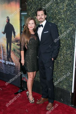 """Julianne Morris, left, and Kristoffer Polaha arrive at the LA Premiere of """"Where Hope Grows"""" held at Arclight Cinemas Hollywood on in Los Angeles"""