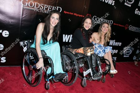 "Mia Schaikewitz, from left to right, Auti Angel and Tiphany Adams arrive at the LA Premiere of ""Where Hope Grows"" held at Arclight Cinemas Hollywood on in Los Angeles"