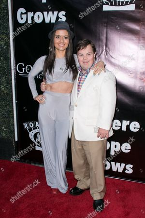 "Danica McKellar, left, and David DeSanctis arrive at the LA Premiere of ""Where Hope Grows"" held at Arclight Cinemas Hollywood on in Los Angeles"