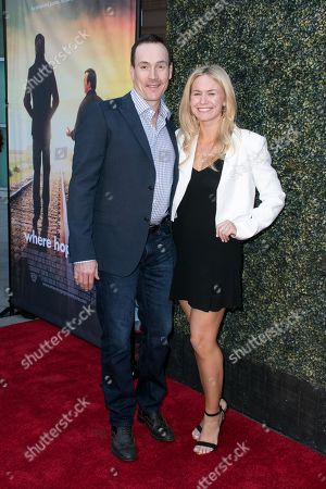 "Chris Klein, left, and Laina Rose Thyfault arrive at the LA Premiere of ""Where Hope Grows"" held at Arclight Cinemas Hollywood on in Los Angeles"
