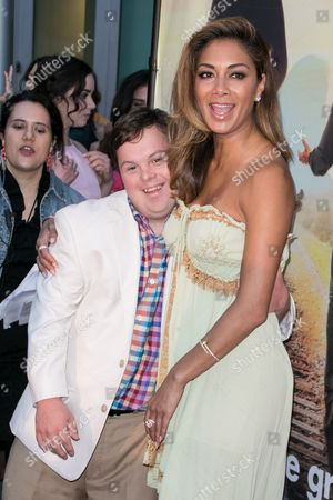 "David DeSanctis, left, and Nicole Scherzinger arrive at the LA Premiere of ""Where Hope Grows"" held at Arclight Cinemas Hollywood on in Los Angeles"