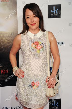 "Stock Photo of Alyssa Lobit arrives at the LA premiere of ""A Resurrection"" at the ArcLight Cinemas on in Los Angeles"
